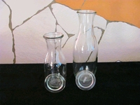Glazen karaf met glazen deksel inhoud (halve liter)  Per stuk